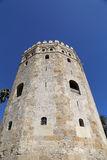 Torre del Oro or Golden Tower (13th century), a medieval Arabic military dodecagonal watchtower in Seville, Andalusia, Spain Royalty Free Stock Image