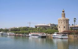 Torre del Oro, The Guadalquivir River in Seville, Andalusia, Spain, Europe. Torre del Oro at the side of The Guadalquivir River in Seville, Andalusia, Spain stock photography