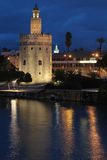 The Torre del Oro by night. SEVILLE, SPAIN, October 19, 2015 : The Torre del Oro by night. The tower was built as a watchtower and defensive barrier on the river Stock Photo