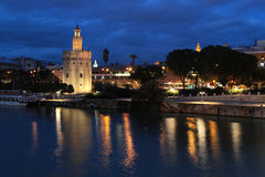 The Torre del Oro by night in Seville. SEVILLE, SPAIN, October 19, 2015 : The Torre del Oro by night. The tower was built as a watchtower and defensive barrier royalty free stock image