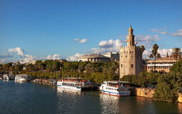 Torre del Oro Old Moorish Watchtower River Seville Spain. Torre del Oro Old Moorish Military Watchtower River Guadalquivr Tour Boats Seville Andalusia Spain Stock Photo