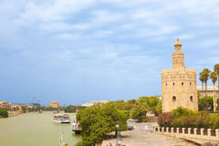 Torre del Oro over Guadalquivir river. 13th Century moorish tower at a cloudy summer day. Sevilla, Spain stock images