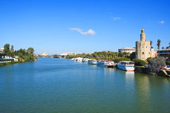 Torre del Oro, Seville. A view of the Guadalquivir River and the Torre del Oro, in Seville, Spain Stock Photos