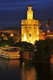 Torre del Oro, Seville, Spain. A view of the Guadalquivir River and the Torre del Oro, in Seville, Spain, at night Stock Photo
