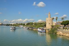 Torre del Oro in Seville, Spain. The Golden Tower is a landmark of Seville on the banks of the Guadalquivir stock photos
