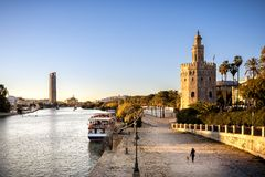 View of Golden Tower Torre del Oro of Seville, Andalusia, Spain over river Guadalquivir at sunset. The Torre del Oro, in Spanish: Torre del Oro, is a military royalty free stock images