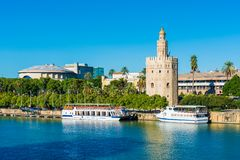 The Torre del Oro tower in Seville, Spain. The Torre del Oro in Seville is an albarrana tower located on the left bank of the Guadalquivir River. It houses the royalty free stock images