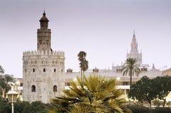 Torre del Oro y Giralda Foto de archivo