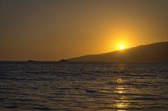 Torre del salvavidas en la puesta del sol Fotografía de archivo