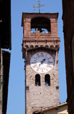 Torre dell& x27;Orologio, Stone Bell Tower in Lucca, Italy. Torre dell& x27;Orologio, Stone Bell Tower & x28;Campanile& x29; topped with brick arch and clock Stock Photography