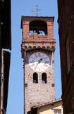 Torre dell& x27;Orologio, Stone Bell Tower in Lucca, Italy. Torre dell& x27;Orologio, Stone Bell Tower & x28;Campanile& x29; topped with brick arch and clock Royalty Free Stock Image
