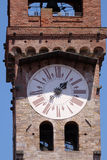 Torre dell& x27;Orologio, Stone Bell Tower in Lucca, Italy. Torre dell& x27;Orologio, Stone Bell Tower & x28;Campanile& x29; topped with brick arch and clock Royalty Free Stock Photo