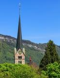 Torre della chiesa di Paul e di St Peter in Stans, Svizzera Fotografia Stock Libera da Diritti