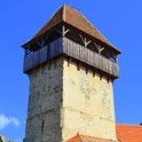 Torre della chiesa fortificata medievale del sassone in Calnic, la Transilvania Fotografia Stock