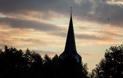 Torre di chiesa al tramonto fotografia stock