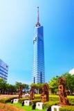 Torre di Fukuoka con le statue indiane del dio Fotografia Stock