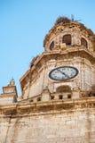 Torre di orologio con il nido del ` s della cicogna Immagine Stock Libera da Diritti