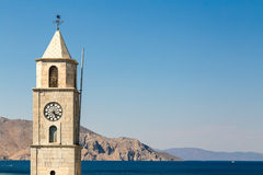 Torre di orologio sui bacini dell'isola di Symi, Grecia Fotografie Stock