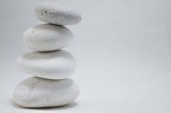 Torre di pietra di benessere su fondo bianco Fotografia Stock