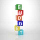 Torre di ruzzolamento del bilancio - le parole di serie dalla lettera taglia Fotografie Stock