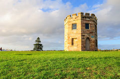 Torre do século XIX da alfândega de Perouse do La no por do sol Foto de Stock Royalty Free