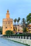 Torre dourada (Torre del Oro) de Sevilha, a Andaluzia, Espanha Fotografia de Stock Royalty Free