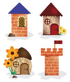 Torre e casas dos desenhos animados Fotos de Stock Royalty Free