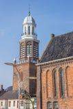 Torre e igreja no mercado central em Winschoten Imagem de Stock Royalty Free