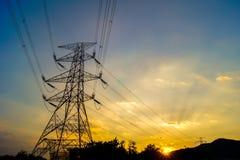 Torre e por do sol de poder Imagens de Stock