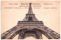 Torre Eiffel em Paris, França, colagem no fundo do cartão do vintage do sepia, cartão da palavra em diversas línguas foto de stock royalty free
