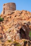 Torre Genoese antiga no Capo Rosso, Córsega fotografia de stock