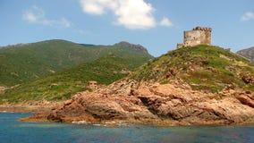 Torre Genoese na costa corsa imagem de stock royalty free