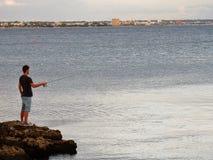 Torre Lapillo -年轻渔夫 图库摄影