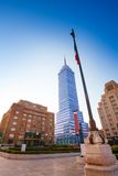 Torre Latinoamericana and Mexican flag in capital. Torre Latinoamericana or tower of Latino America and other buildings and Mexican flag on Juarez avenue and Royalty Free Stock Photo