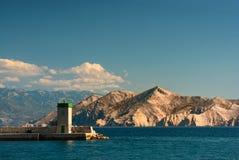 Torre ligera en el mar Imágenes de archivo libres de regalías