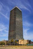 Torre Mapfre skyscraper. Barcelona, Spain - March 26, 2017: Torre Mapfre is a skyscraper in the Olympic Port, the maritime neighborhood of the Old City of Royalty Free Stock Images