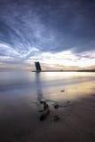 Torre moderna en la puesta del sol Fotos de archivo