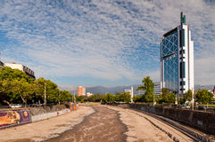 Torre Telefonica Building and the fast-flowing Mapocho River - S Stock Image