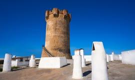 Torre Valencia de Paterna y chimeneas de las casas de la cueva fotografía de archivo libre de regalías
