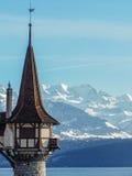 Torre vieja en un lago suizo Foto de archivo libre de regalías