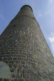 Torre y cielo de piedra Fotografía de archivo