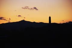 Torre y puesta del sol Fotografía de archivo libre de regalías