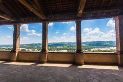 Torrechiara Castle in the Province of Parma, Emilia Romagna Italy. View of the castle and the landscape with sky, hills and rural dwellings around Torrechiara in royalty free stock photos