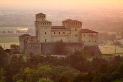 Torrechiara castle at sunrise. Impressive architecture of Italian (Parma) Torrechiara castle in sunrise light Stock Photos