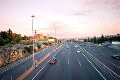 Torrelodones, Madrid,Spain. Cars on highway passing Torrelodones town at sunset stock image