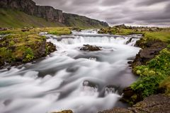 Torrent in the middle of a meadow in iceland stock photography