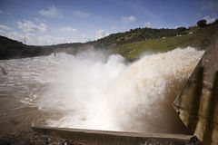 Torrent of water expelled the Guadalmellato River from the reservoir of San Rafael de Navallana Stock Photo