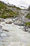 Torrente nelle alte montagne in Montafon, Austria Fotografie Stock