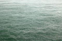 Torrential rain on the sea Stock Photo