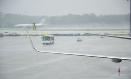 An airport in a torrential rain. Torrential rain, thunder and lightning, aircraft waiting for take-off orders stock images